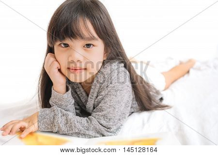 portrait asia children education and school concept -student girl reading book
