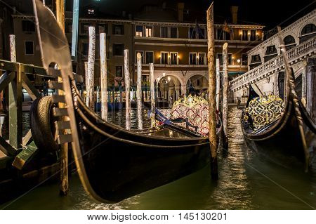 Canal with boats and gondola in romantic Venice