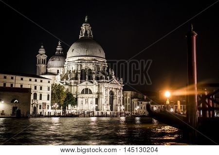Cathedral at the big Canal with boats and gondola in romantic Venice