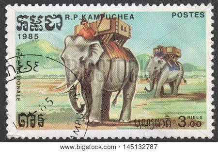 MOSCOW RUSSIA - CIRCA AUGUST 2016: a stamp printed in CAMBODIA shows an Asian Elephant (Elephas maximus) with Kornak and Howdah the series