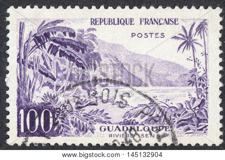 MOSCOW RUSSIA - CIRCA AUGUST 2016: a stamp printed in FRANCE shows view of Sens River Guadeloupe the series