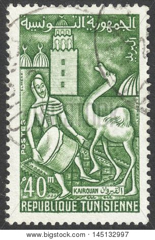 MOSCOW RUSSIA - CIRCA AUGUST 2016: a stamp printed in TUNISIA shows a festival at Kairouan drummer and camel the series