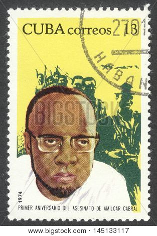 MOSCOW RUSSIA - CIRCA AUGUST 2016: a stamp printed in CUBA shows a portrait of Amilcar Cabral dedicated to the 1st Anniversary of the Death of Amilcar Cabral circa 1974