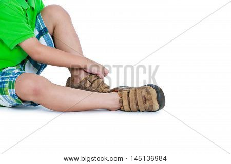 Side View Of Child Put Leather Shoes On. Isolated On White Background.