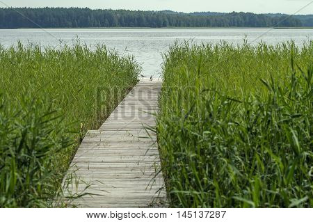 Wooden Walkway To The Large Lake