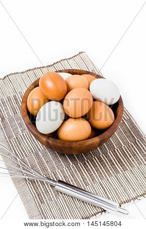 Eggs In Wooden Bowl On White Backgrond.