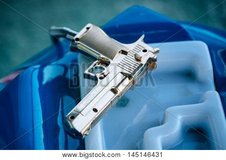 Plastic toy gun for arcade video game selective focus