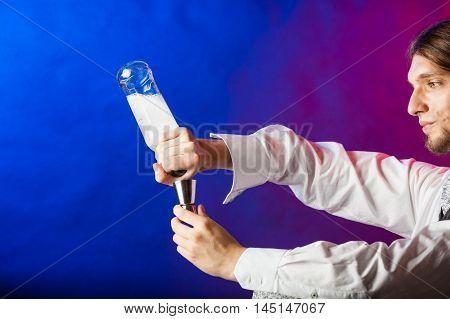Bartender Pouring Liquor Into Glass.