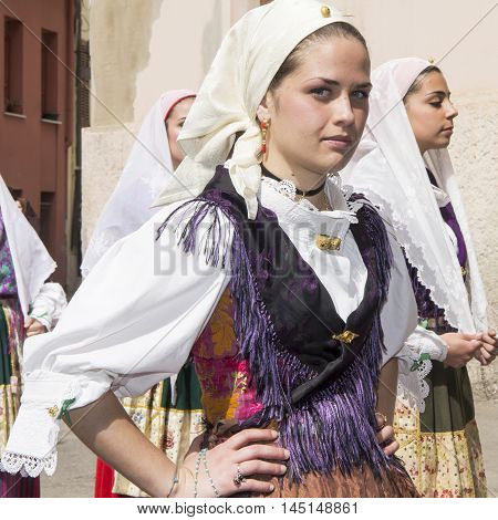 CAGLIARI, ITALY - May 1, 2013: 357th Religious Procession of Sant'Efisio - Sardinia - portrait of a beautiful girl in traditional Sardinian costume