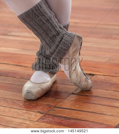 Low Section Of Ballerina Performing On Floor