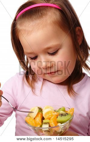 Little Girl Eats Fruit Salad