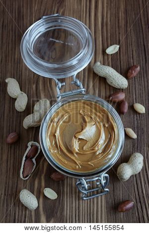 Peanut Butter In A Glass Jar And Peanuts