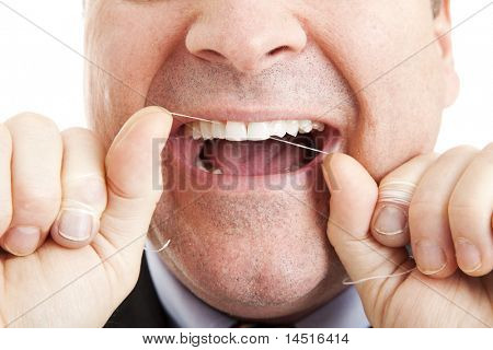 Closeup of a man flossing his teeth with dental floss.