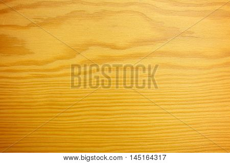 Brown has a beautiful wooden floor used as a home office wall or walls.