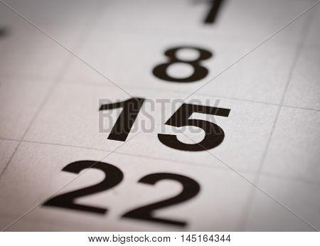 close up black white calendar fifteen and twenty-two