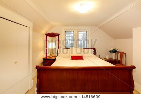Small Bedroom With Low Ceiling And Large Bed