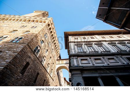 View from below on Vecchio palace and Uffizi museum in Florence old town