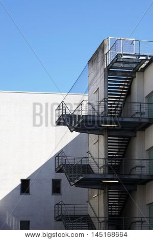 back of building with external fire exit stairs of outside fire escape staircase