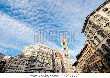 Famous Santa Maria del Fiore cathedral church with Baptistery in Florence. View from below