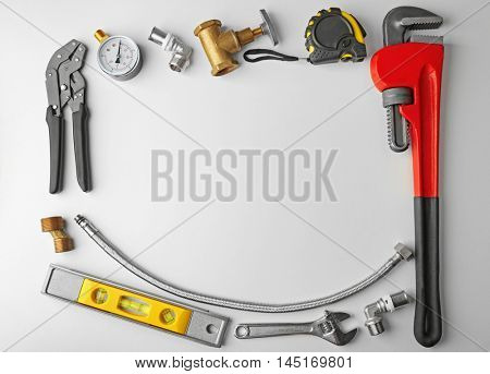 Plumber tools frame isolated on white