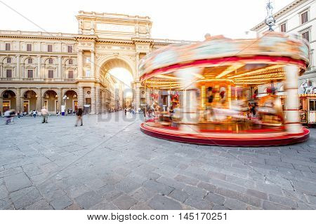 Republic square with the illuminated motion blurred carrousel in Florence