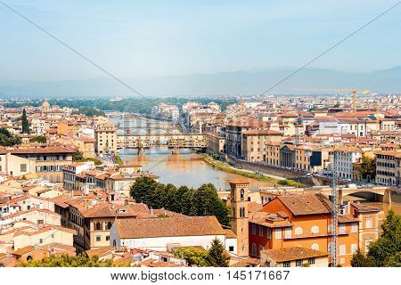 Florence aerial cityscape view from Michelangelo square on the old town and river with bridges in Italy