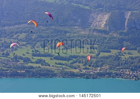 Paragliders flying above Lake Annecy in France
