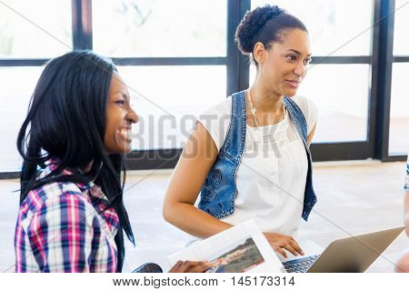 Young office workers or students discussing
