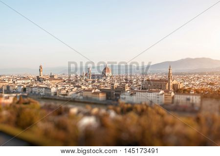 Florence aerial cityscape view from Michelangelo square on the old town with famous cathedral church and river in the morning in Italy