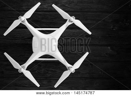 concept quadrocopter on a black wooden background