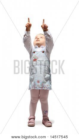Little blond girl in jean sundress points two fingers up and looks up
