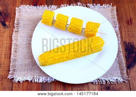 dish with boiled corns on the plate