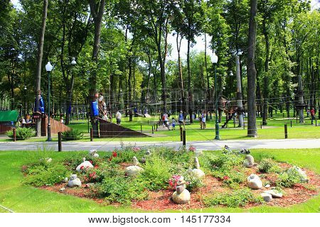 Kharkiv / Ukraine. 07 August 2016: People have a rest in city park with decorated lawn. 07 August 2016 in Kharkiv / Ukraine.