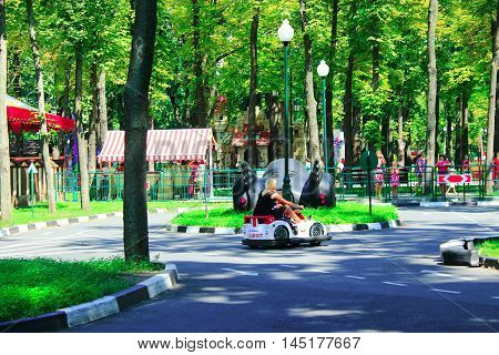 07 August 2016 in Kharkiv / Ukraine.children with their parents drive the electric cars in Gorky park in Kharkiv. 07 August 2016 in Kharkiv / Ukraine.