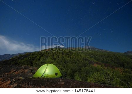 starry night and lighting tent on Etna Volcano, Sicily