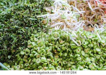 long bean and vegetables:Close upselect focus front  with shallow depth of field. space for add text above and may be used as background :