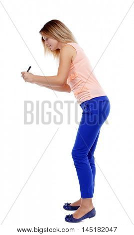 back view of writing beautiful woman. blonde in a pink t-shirt wrote marker.