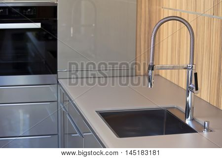 modern  grey kitchen with stainless steel sink