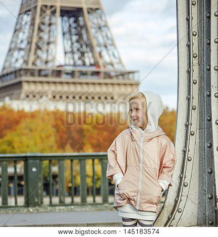 Active Child On Pont De Bir-hakeim Bridge In Paris Looking Aside