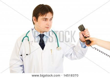 Serious medical doctor taking phone from secretary isolated on white