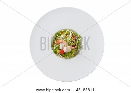 Top view of Modern style sunflower sprout salad with shrimp in ceramic dish isolated on white background