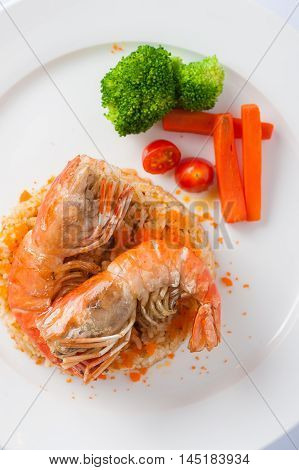 Top view of Modern thai style shrimp fried rice with river prawn in ceramic dish