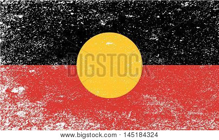 The flag of the Australian Aboriginal people with grunge