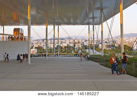 ATHENS, GREECE - AUGUST 28, 2016: People at the new building of National Opera in Stavros Niarchos Foundation Cultural Center, and view of Athens on August 28, 2016.