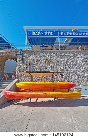 Stacked Plastic Canoes And El Pescador Restaurant