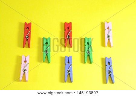 Colorful clothespins arranged in a single row