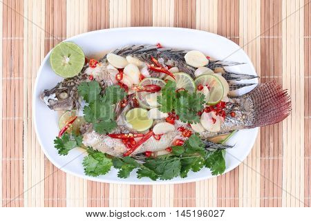 Tilapia fish streamed lemon is food for good life on Chinese festival