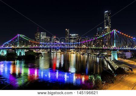 BRISBANE, AUSTRALIA - AUGUST 28 2016: Story Bridge by Night -  multi-coloured lights  (Blue, Pink, Green, Orange, Purple) for Brisbane Writers Festival.