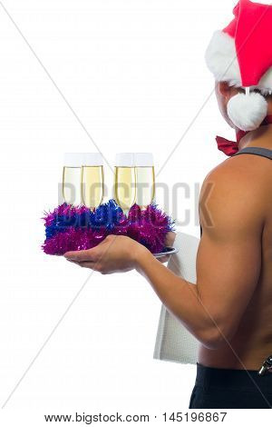 bartender in a red cap carries champagne glasses
