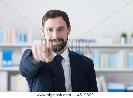 Smiling Businessman Pointing At Camera